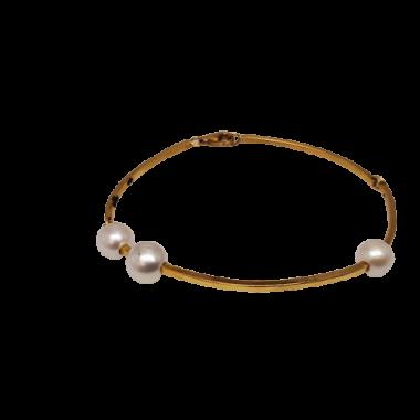 Esclave avec perles d'or